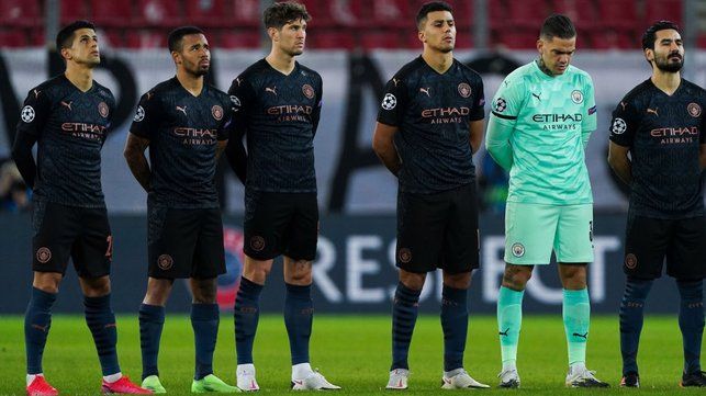 SQUAD GOALS : The starting team arrive on the pitch in Greece and observe a minute of silence in memory of the iconic Diego Maradona, who sadly passed away.