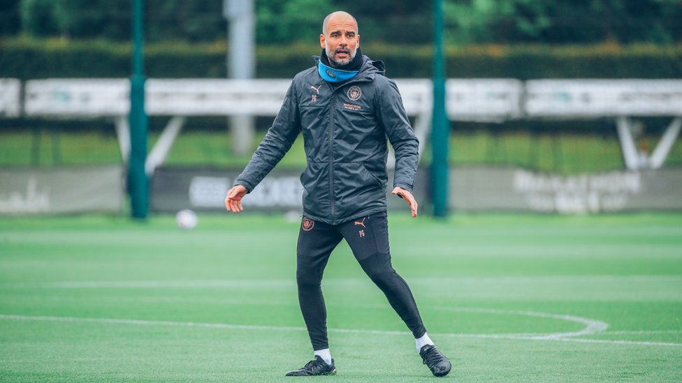 IN CHARGE : Pep Guardiola gets involved with Friday's session.