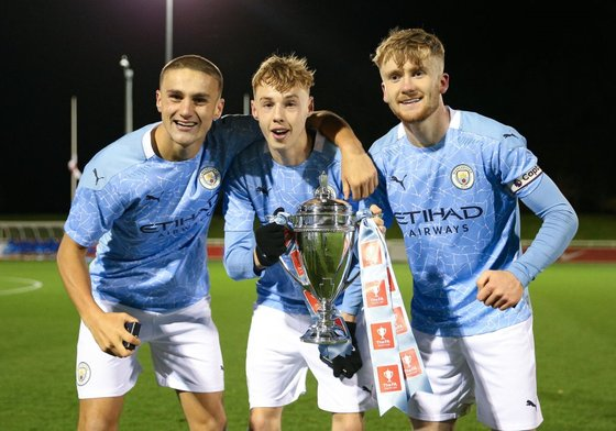 Harwood-Bellis with Cole Palmer and Tommy Doyle after Manchester City's FA Youth Cup win 2020
