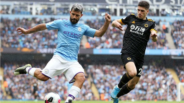 PROBING : Aguero looks to get the better of the Wolves defence.