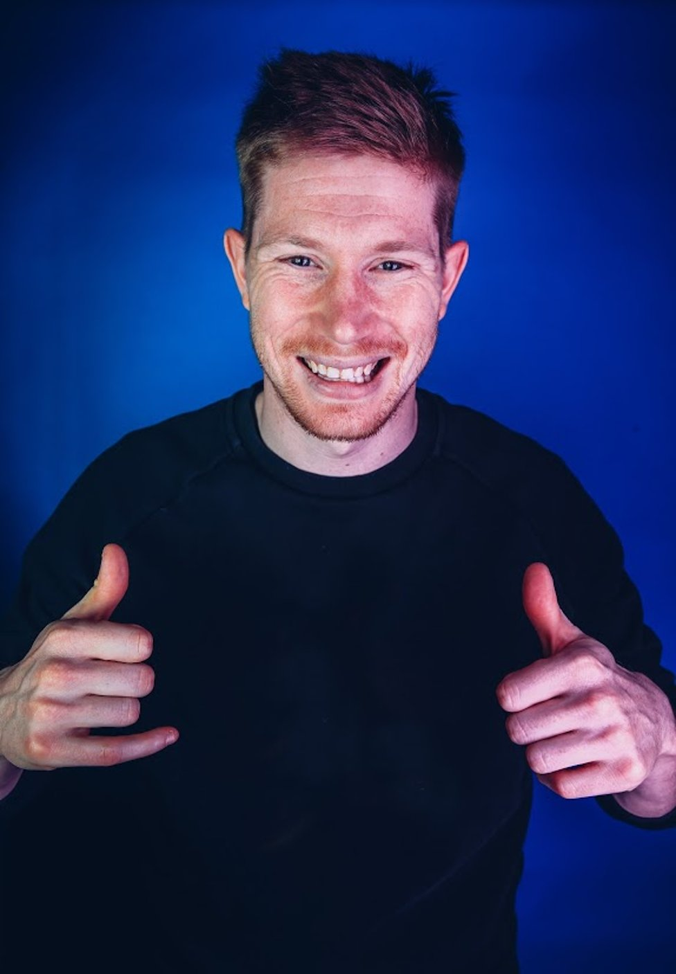 THUMBS UP: De Bruyne had every reason to celebrate having helped City to regain the Premier League title and retain the Carabao Cup