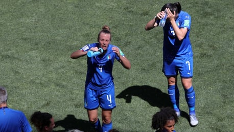 MUCH NEEDED: Italy take on water in the cooling break taken in their match against the Netherlands.