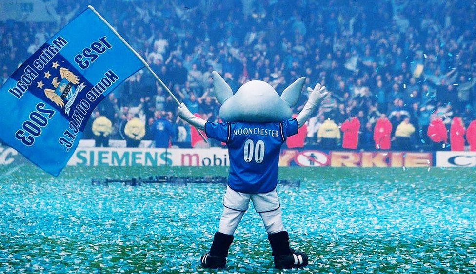 BLUE MOONCHESTER: Our Club mascot gets the fans in the party spirit