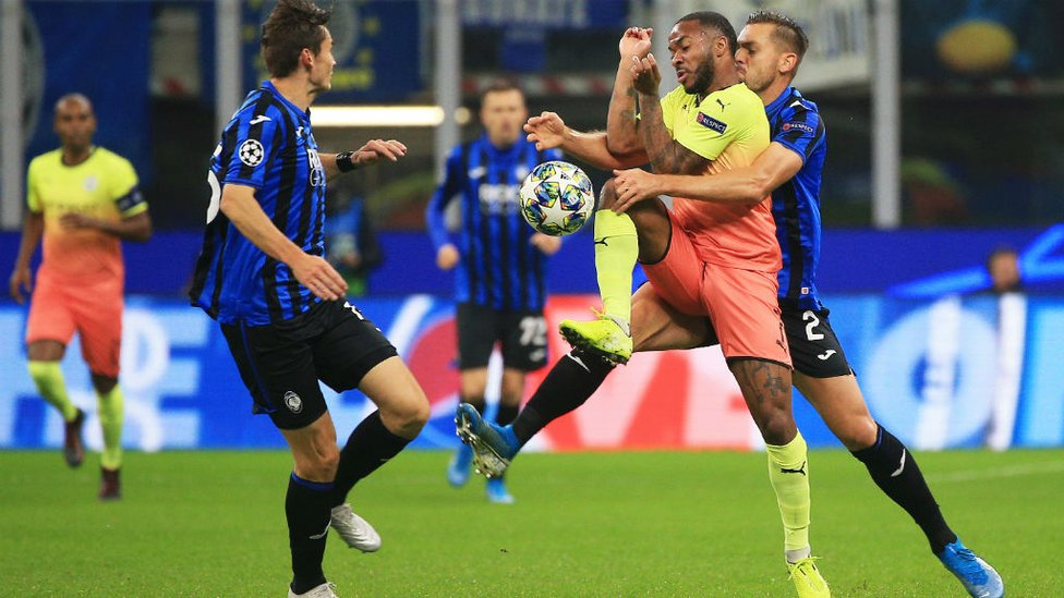 ARM WRESTLE : Raheem comes under close attention from the Atalanta defence