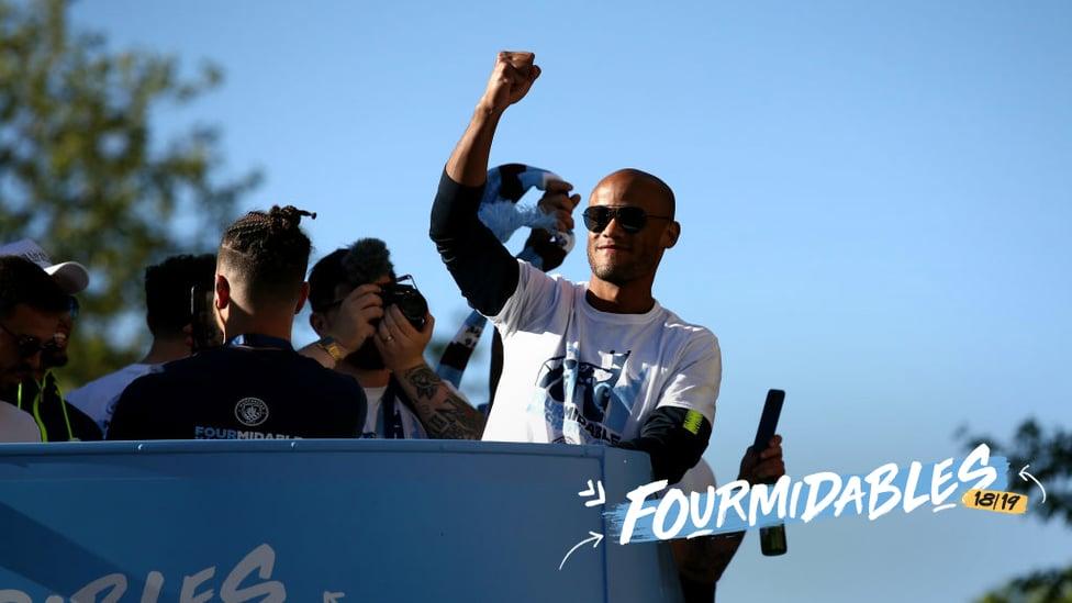 LEADER : Vincent Kompany salutes fans at the champions parade.