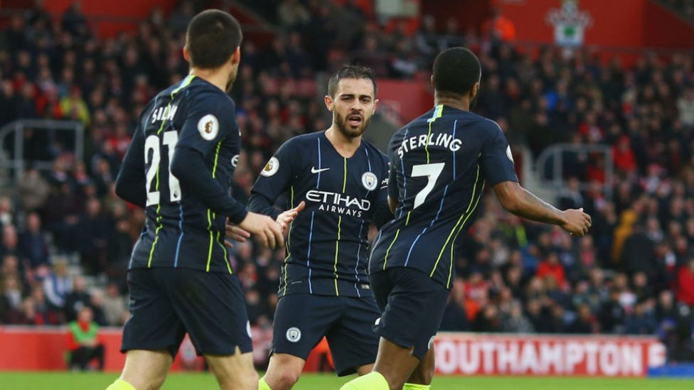 HELPING HAND : Bernardo celebrates with Raheem Sterling after Ward-Prowse's own goal