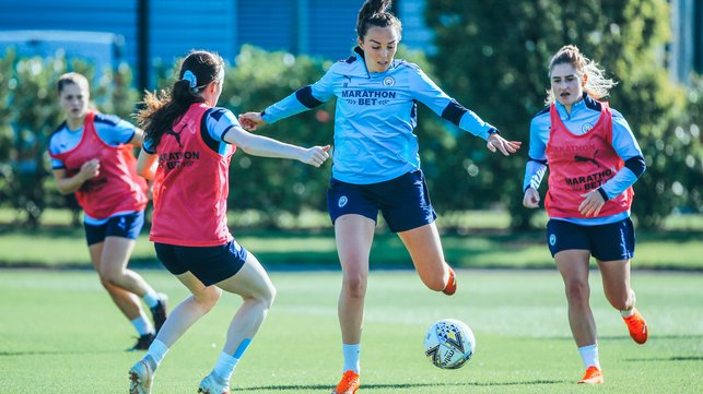 ACTION STATIONS: Caroline Weir vies for the ball with Rose Lavelle