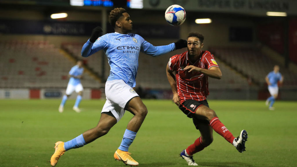 ON THE BALL: Jayden Braaf vies for possession against Lincoln's Liam Bridcutt