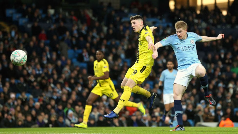 ON THE MARK : Kevin De Bruyne heads home to give City an early lead