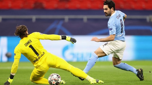 DOUBLE TROUBLE: Ilkay Gundogan makes it two with a clinical finish under Yann Sommer