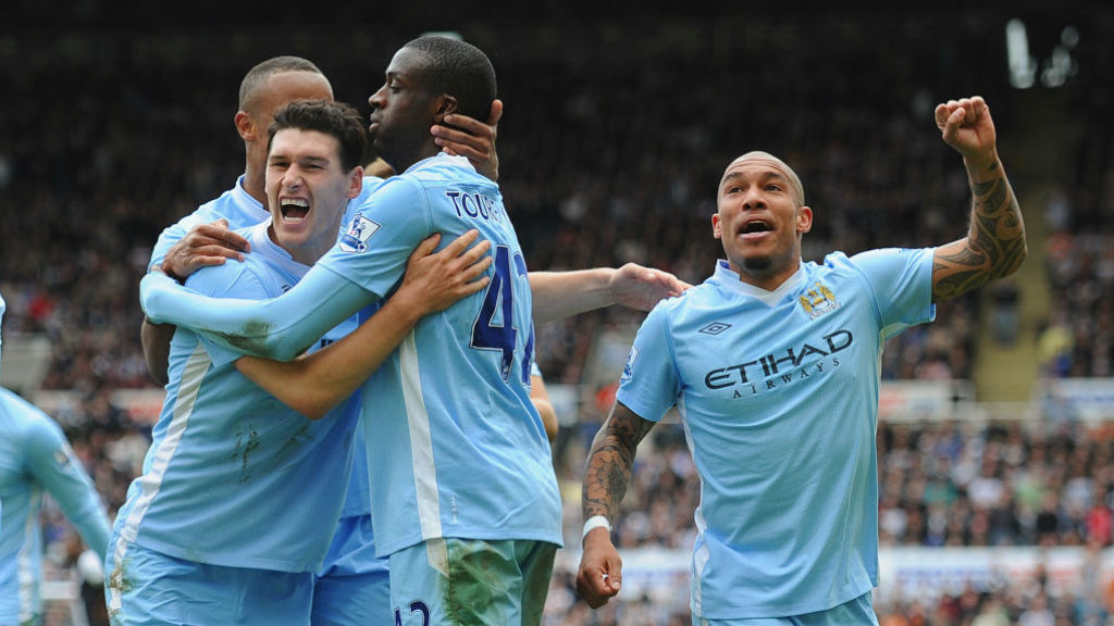 THAT WINNING FEELING: Gareth Barry celebrates with Yaya Toure and Nige De Jong during our crucial win at Newcastle in 2012