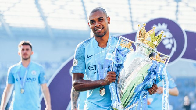 CROWN JEWEL : Ferna proudly holds the Premier League trophy after 2019 title defence