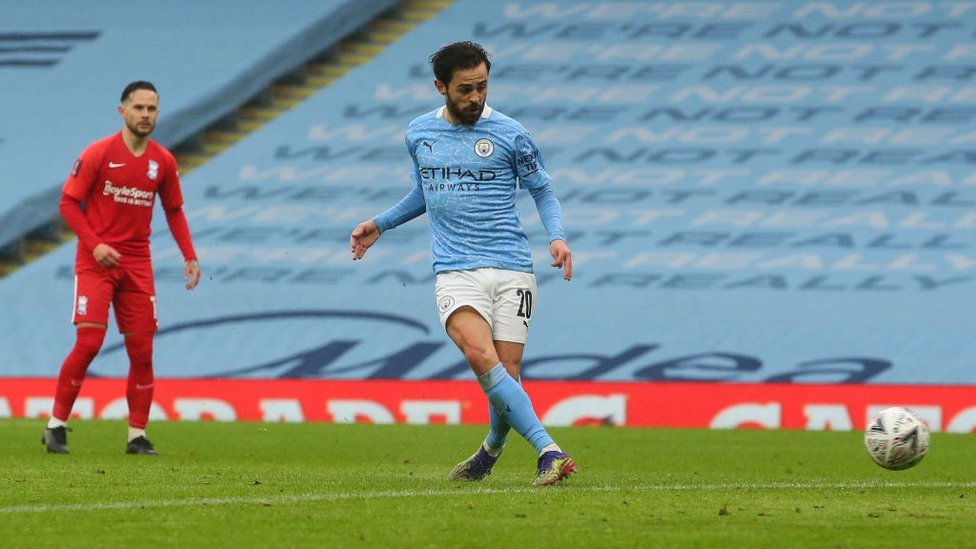 DOUBLE DELIGHT : Bernado finishes off a slick move to net his and City's second.