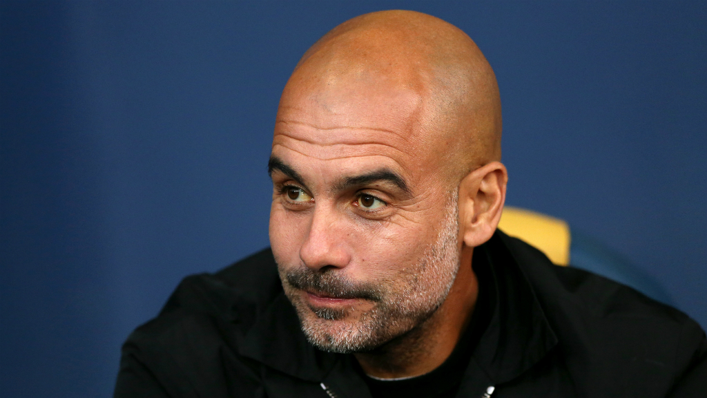 THE BOSS : Pep Guardiola watches on