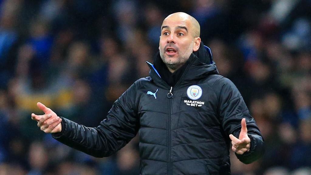 SIDELINE: Pep Guardiola delivers his instructions against Port Vale.