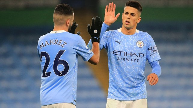 OVER AND OUT : Mahrez and Cancelo celebrate the victory as the referee blows the full-time whistle.