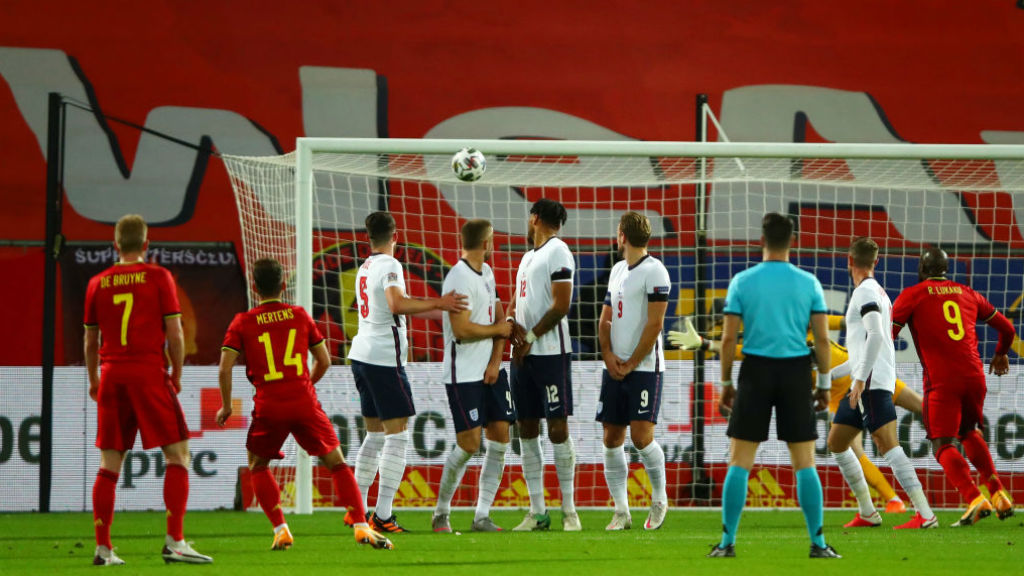 TAKE THAT: Kevin De Bruyne looks on as Dries Mehrtens doubles Belgium's lead against England with a free-kick