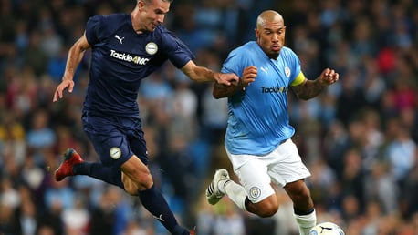 Nigel De Jong takes on Robin Van Persie at Vincent Kompany's testimonial.