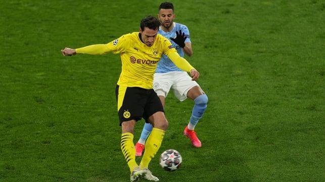 PRESSING HIGH: Riyad Mahrez applies pressure to Mats Hummels