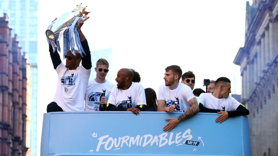 CAPTAIN FANTASTIC : Vincent Kompany hoists the Premier League trophy aloft for the final time in sky blue