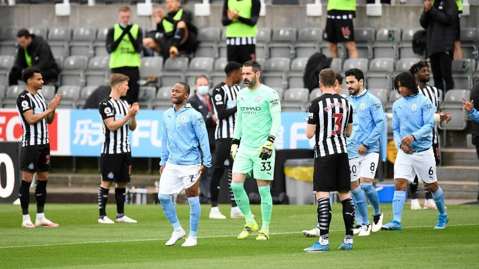 GUARD OF HONOUR: The Newcastle players congratulate the lads on being crowned Premier League champions