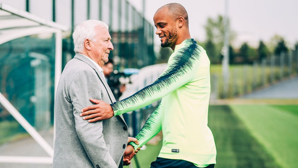 MEETING MIKE : Vincent Kompany chats with City legend Mike Summerbee