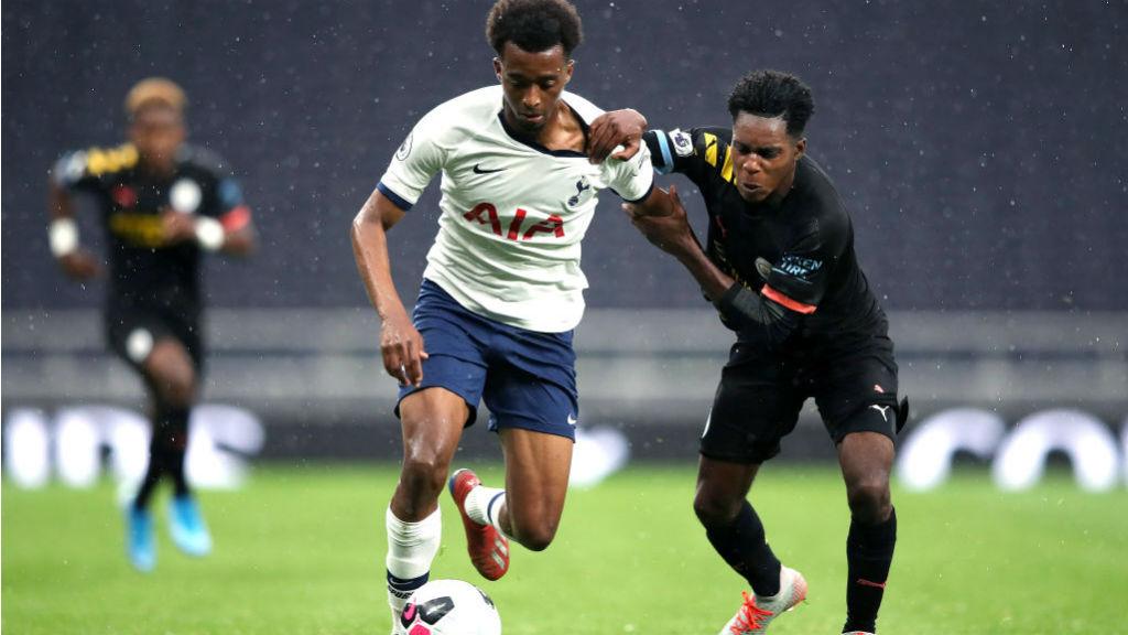 ACTION STATIONS : Jeremie Frimpong challenges Spurs' Tashan Oakley-Boothe