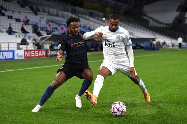 BATTLE : Sterling fights for possession