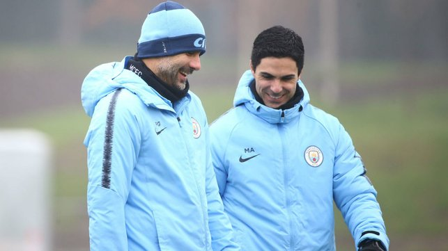 SPRING IN THEIR PEP : Pep Guardiola and Mikel Arteta share a joke during training