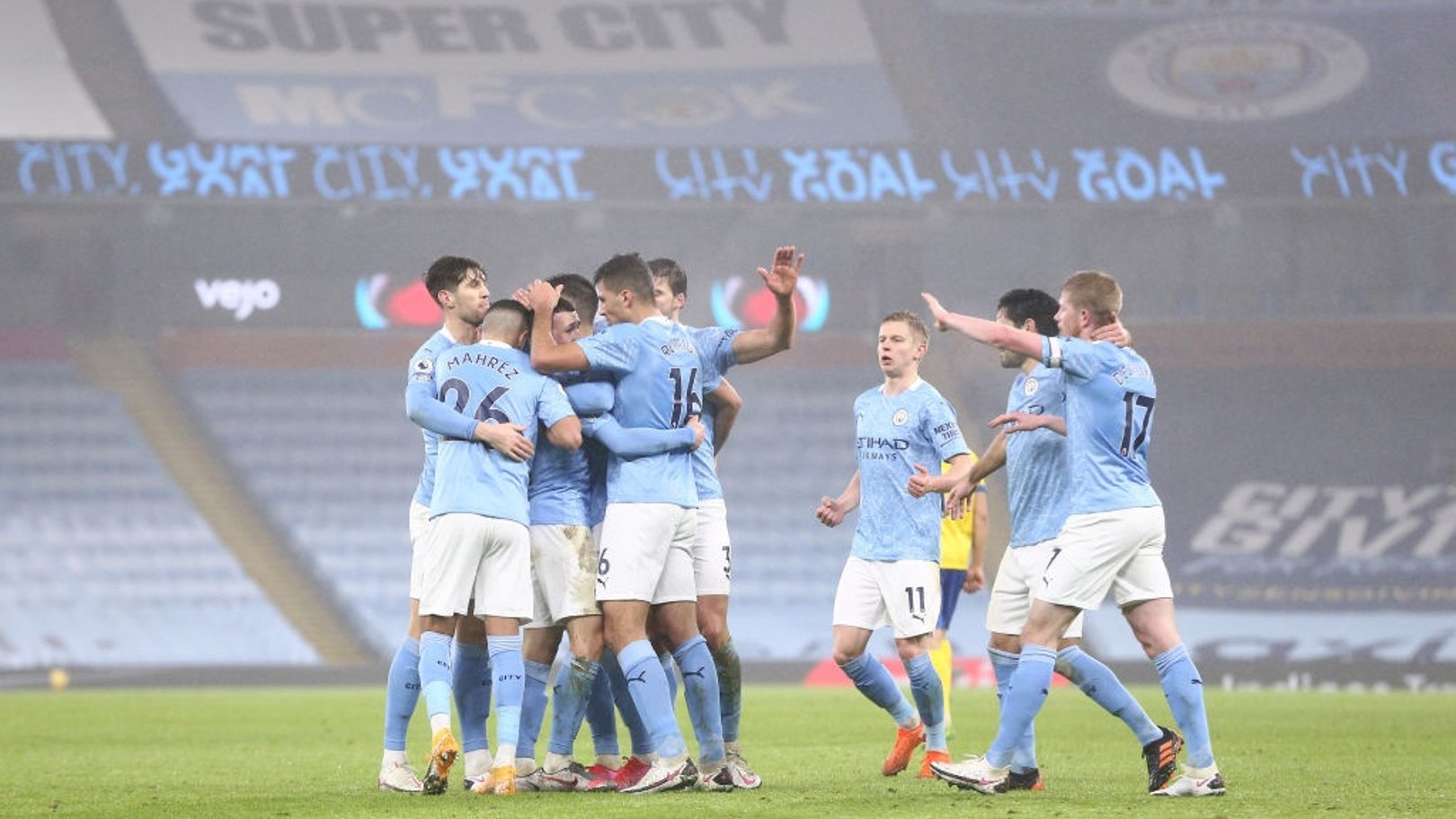 GROUP HUG: The players share the love after Foden's opener.