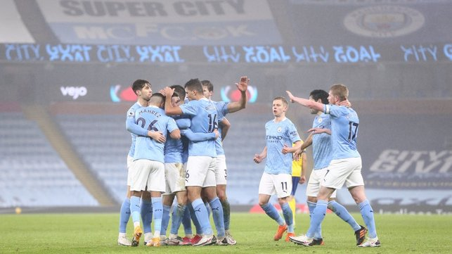GROUP HUG : The players share the love after Foden's opener.