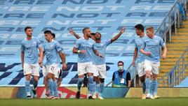DEADLOCK BROKEN: The team celebrate Raheem's 100th City goal
