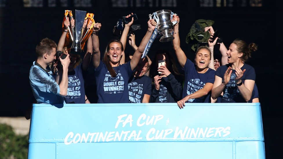 DOUBLE WINNERS : Our women's team bus led the procession, showcasing their double success - the Continental Cup and FA Women's Cups!