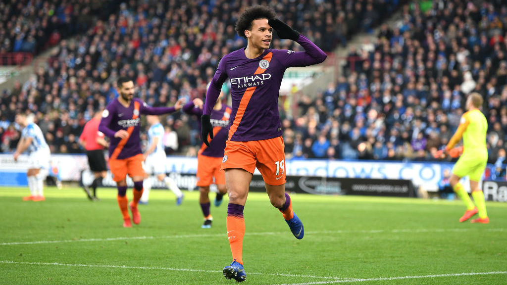 IN-SANE ATTACK : Leroy Sane celebrates the Blues' second goal in two minutes, and their third of the afternoon