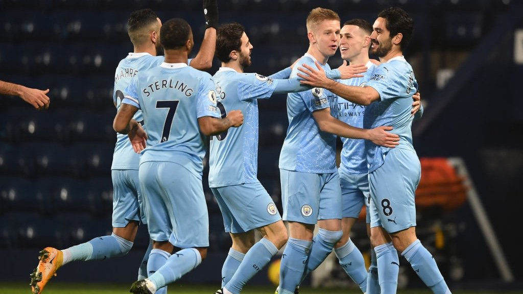 PERFECT START: The players rush over to congratulate Gundogan after his accurate finish.