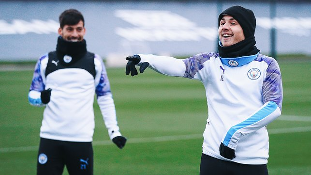 ON POINT : Angelino fires out a training pointer much to David Silva' s amusement
