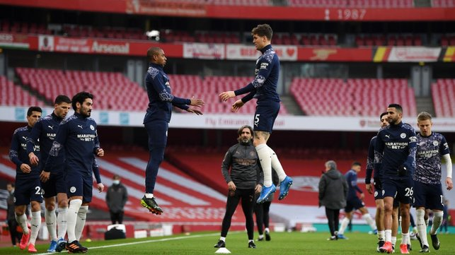 LEVITATING : Stones and Fernandinho hang in the air as the warm up winds down.