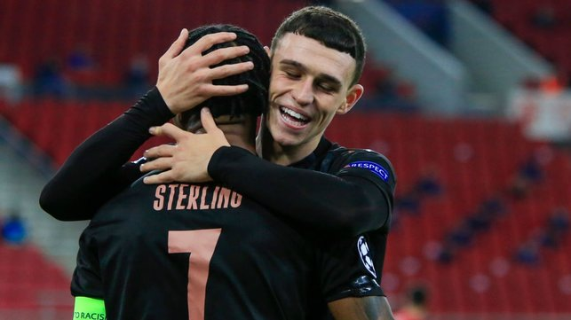 ALL SMILES : Foden embraces Sterling after the skipper's wonderful assist.