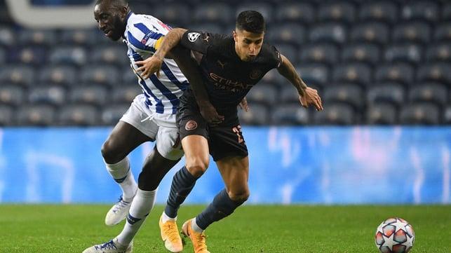 CANCELO'D OUT: Joao Cancelo shields possession from Moussa Marega