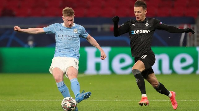 DELIGHTFUL DE BRUYNE: KDB releases the ball under close attentions from Hannes Wolf