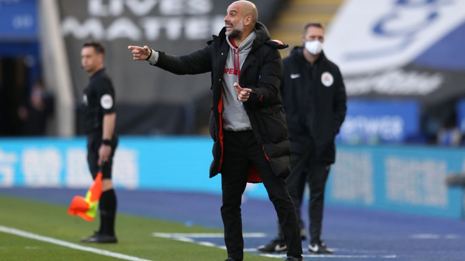 PEP TALK: The boss passes on some instructions from the touchline.