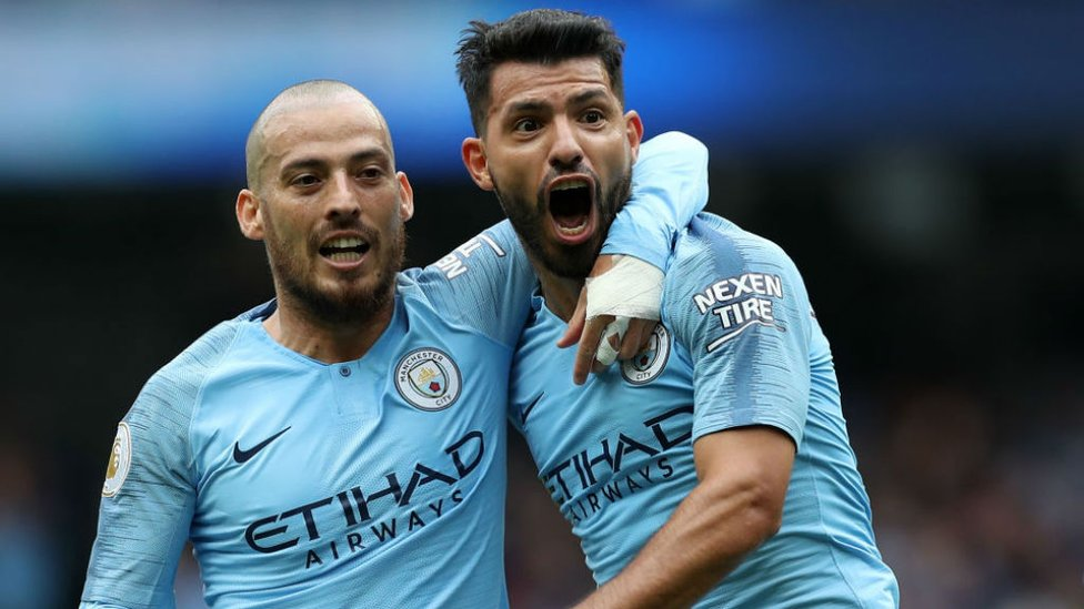 DEADLY DUO : Sergio and midfield maestro David Silva can't contain their joy after Kun's latest City hat-trick, this time against Huddersfield during our 6-1 thrashing of the Tykes in August 2018