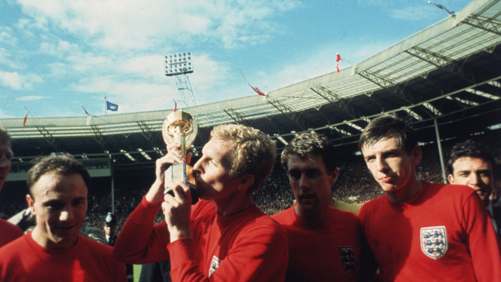 MOORE THAN THIS : Bobby kisses the Jules Rimet trophy