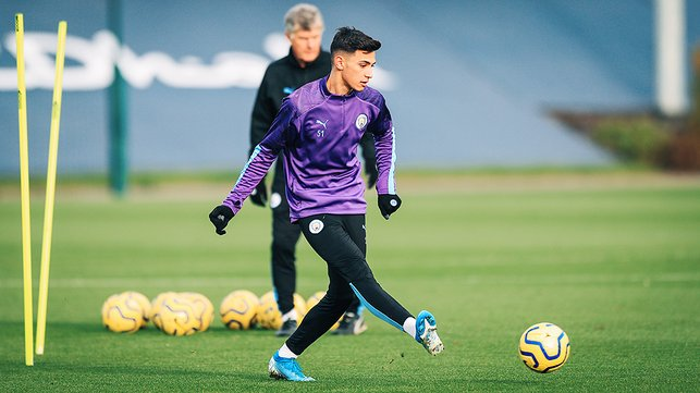 BY THE RIGHT : Nabil Touaizi works on his passing drills