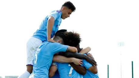 GET IN: City U18s celebrate against Liverpool.