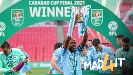 CAPTAIN FANTASTIC: Fernandinho lifts the trophy!