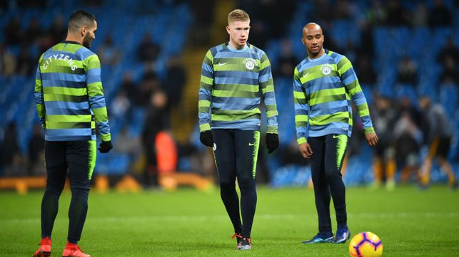 EYES ON THE PRIZE : Delph, Gundogan and De Bruyne warm up ahead of Wolves clash