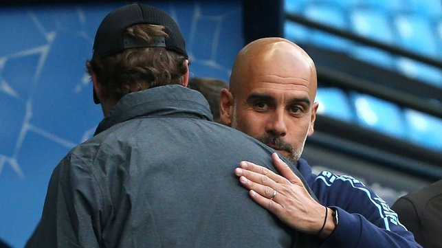 TACTICIANS : Guardiola and Klopp share a warm embrace before the match begins.