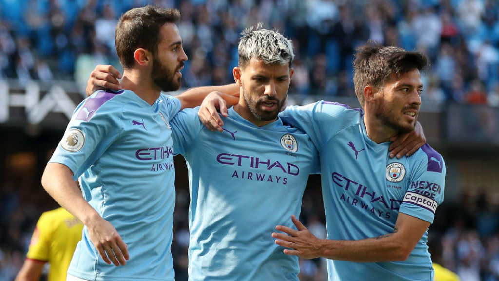 Bernardo and David Silva salute Sergio Aguero after his 100th goal at the Etihad
