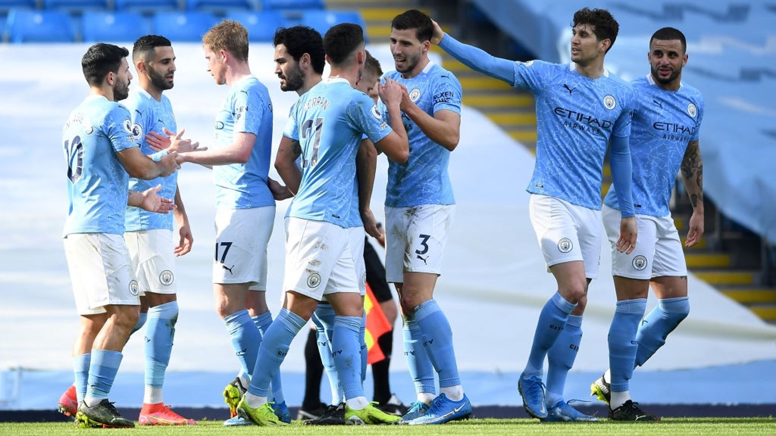 GROUP HUG: The players gather to congratulate Dias and De Bruyne after the opener.